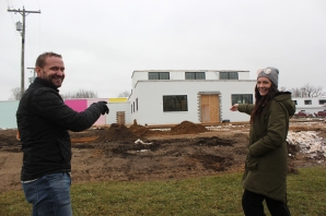 Jamie and Windy Clark proudly point to the east side of the Clark Logic property in Schoolcraft that will become the Wind and James event center in 2017.