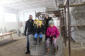 The Clark family gather in the soon to be part of the event space in the former Arco Building in Schoolcraft. Left right are Jamie, Bowie age 6, Remy age 3, Windy and Charli age 7.