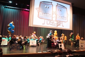 The stage was full of intense and excited children and adults during last year's competition for Battle of the Books at Schoolcraft High School Performing Arts Center.
