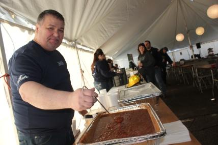 Todd Bowen, of Taco Bob's in Vicksburg, serves up his specially made chili.