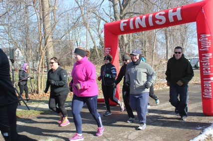Runners in the 5K Chili Dash finish strong in 2016 run.
