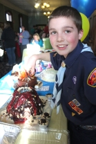 Cub scouts love cake. Proof is shown on the left by Grant VanWoert digging into the lava confection cake he prepared last year.