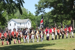 The British and Colonial troops parade on the grounds of the Vicksburg Historic Village in the first Battle of Sunset Lake in 2016.
