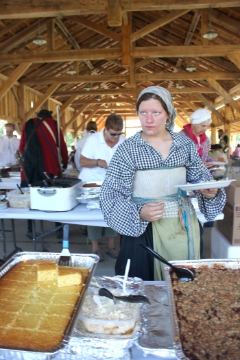A woman re-enactor samples the feast prepared for the 200 guests of the Vicksburg Historic Society in 2016. The food was prepared by members of St. Martin's Catholic Church, Vicksburg United Methodist Church, Chapman Memorial Church of the Nazarene, Lakeland Reformed Church and overseen by Robin Maple, Pam Best, and Marian Steffens.