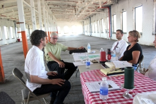 Chris Moore, Gene Burns, Steve Sielatycki and Jackie Koney hold a meeting on the fifth floor of the mill in the summer of 2015.