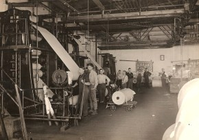 Paper rolls and the mill hands in the 1920s.