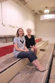 Darcy Bolles and Sue Hendriksma are seated on the gymnasium bleachers in the Schoolcraft Early Elementary building. They have been boarded up from view for many years. Sealed bids for the building are being accepted until August 29.