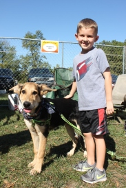 Sam Snyder would love to adopt the dog he is petting when he attended the Harvest Festival in September.