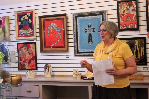 Lisa Beams showcases the art work on display at the new location for the Vicksburg Cultural Arts Center at 101 E. Prairie Street.