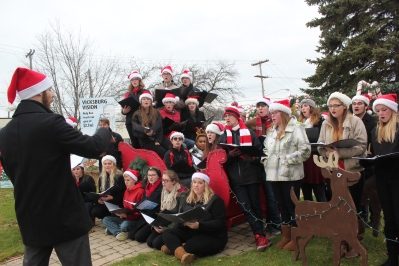 Vicksburg High School's choir members entertain in Oswalt Park during the 2016 Christmas in the Village under the direction of Dustin Morris (not pictured).