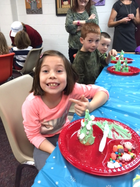 Erin Willoughby has a plate full of candy from the event first staged at the library in 2016.
