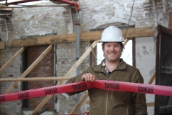 Chris Moore, owner of Paper City Development, toured the construction progress at the mill recently. He noted ironically the danger tape that encloses the roof work taking place on the east wing which will house the brewery when it is complete.