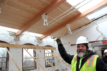 Shown pointing up to the roof is Ken Coombs, the foreman of Frederick Construction, which is the building contractor for the mill renovations.