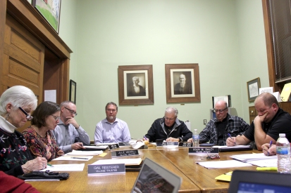 The Vicksburg Village Council mulls things over at its December meeting in the Vicksburg Library. They are from left to right: Gail Reisterer, Julie Merrill, James Earl, Tim Frisbie, Bill Adams, Ron Smith and Colin Bailey.