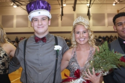Schoolcraft's Kennedy Leighton changed from her basketball uniform to a formal gown to be announced as queen of the Homecoming festivities. Zach Engle was selected as king.