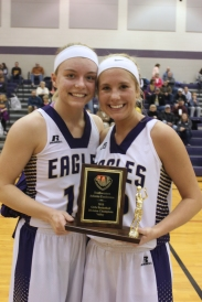 Lydia Goble and Kennedy Leighton hold the SAC league trophy for their championship season awarded after the Constantine game.