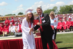 Two Vicksburg school board members handed their daughter and son their diploma during graduation ceremonies. Seen above are Anna and David Schriemer. Two other longtime board members were able to hand diplomas to their grandchildren: President Skip Knowles to Anna Knowles and vice president Carol Lohman to Lauren Burke.