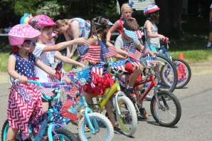 Children line up early to ride their decorated bicycles the quarter mile down 42nd street in the Fulton Memorial Day parade.