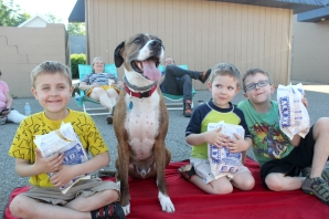 These kids were all primed to watch cartoons at the movie night in downtown Vicksburg. They are from left to right: Harry, Charlie and Brody Bosel, the children of Dane and Lindsey Bosel, the owners of the Distant Whistle. The dog in the middle is a good friend of theirs, Simon who lives near their dad's store.