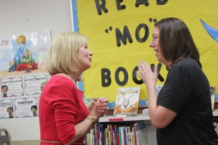 Sheila Alles, interim state superintendent of education has a heart to heart chat with Laura Chang upon her selection as Michigan Teacher of the Year. She teaches in a classroom of second graders at Sunset Lake Elementary.