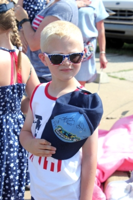 Mr. Cool salutes the American flag as it passes by in the arms of the American Legion honor guard in the Schoolcraft 4th of July parade.