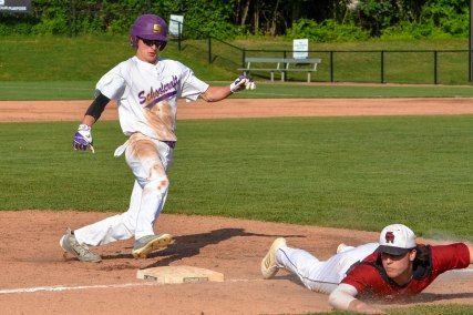 Austin Edwards rounds the bases to score Schoolcraft's first run of the semi-final state tournament game.