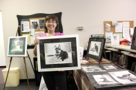 Lori Ensing, who does pet portraits, holds up a sample of her work.