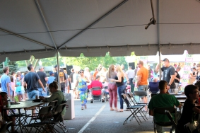 Patrons at the 2016 Taste of Vicksburg enjoy the sun instead of sitting in the big tent.