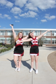 Cheerleaders Aislyn Brown and Makenna Pillars celebrate the west side courtyard redesign before the opening of the 2018/19 school year at Vicksburg High School.