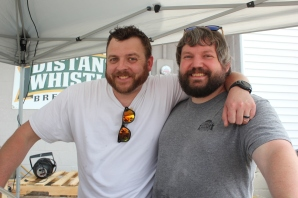 Dane Bosel and Andy Clouse celebrate their second anniversary with a party in the parking lot behind their brewery on S. Main Street.
