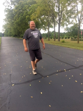 Rusty Stitt is shown on a practice jaunt getting ready for the 50 mile walk/bike to raise money for scholarships.