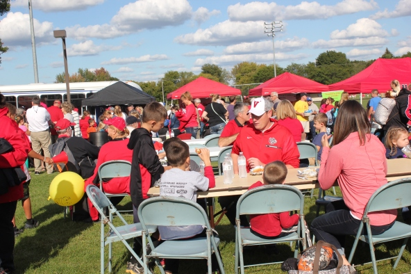 Free hot dogs at the Vicksburg High School annual Tailgate are enjoyed by grandparents, parents and kids before the high school football game gets underway.