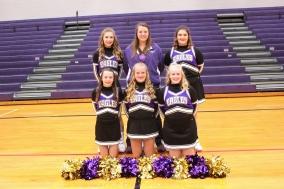 Cheer Front row, from left: Kerstin Rhoades, Alana Reed, Seyanna Smith. Back row, from left: McKenna Olivarez, Coach Allie Hufford, Annalee Miller-Hammond.