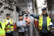 Touring the very depths of the Mill to plan for future renovation are from left to right: John Kern, Jackie Koney, Guy Bazanni, and Greg Bjarko, an architect working on plans for the Mill.