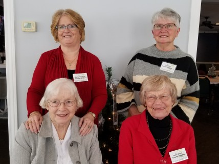 Four of the founding members of the Victorian Garden Club were at the party. They are seated from left: Bonnie Holmes and Joyce Green. Standing from left: Kathy Skippers and Teri Clark.
