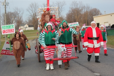 The Reindeer Union on strike for extra hay on Christmas Day won first place in the float competition in 2017. The lively elves pulling the decorated wagon even performed a dance routine along the parade route. Second place went to the Indian Lake Girl Scouts and third place to the Vicksburg schools transportation department.