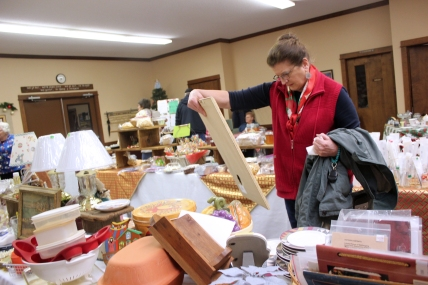 Shoppers at the Schoolcraft United Methodist Church enjoy the array of crafts and food items available for purchase.