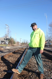 Randy Schippers, head of the Vicksburg Department of Public Works inspects the rail at the Boulevard Street railroad crossing where a Canadian National train's boxcar derailed.
