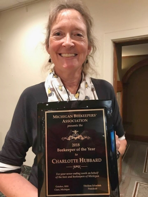 Charlotte Hubbard accepting her Beekeeper of the Year award.