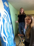 Vicksburg Cultural Arts Center students work on the octopus painting that covers an upstairs window over the Hill's Pharmacy building on Main Street.