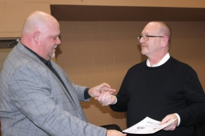 Superintendent Rusty Stitt thanks Mike Rochholz for his years of encouragement.