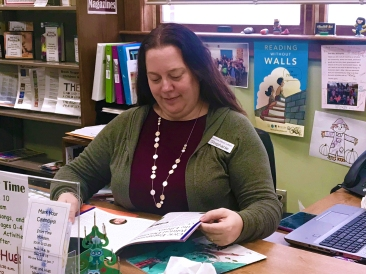 Youth Librarian Stephanie Willoughby works on selecting new books for the Children's section of the Vicksburg District Library.