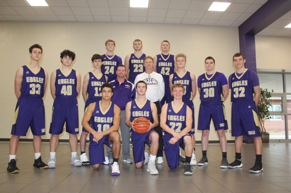 Varsity Basketball: Kneeling, from left: Kobe Clark, Brady Flynn, Aiden Hursey. Middle row, standing from left: Stephen Schultz, Mitch Simonds, Terry Smith, Assistant Coach Adam Sziede, Head Coach Randy Small, Trevor DeGroote, Connor Nutt, Brice Walther. Standing in back, from left: Tyler DeGroote, Chris Cooper, Bryce VanderWiere.