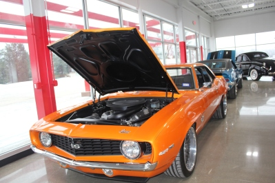 A DutchBoys hotrod is shown as it sits with the hood open in their new showroom at 820 W. Prairie Street in Vicksburg.