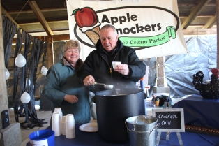 Paula and Bill Hochstetler serve chicken chili from Apple Knockers at the 2018 Chili Cookoff. They and 20 other vendors will be serving various kinds of chili this year.