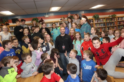 Schoolcraft fifth grade students crowd around Matt Wagner, a member of the Diavolo troupe that performed at Miller Auditorium in February. He grew up living on Barton Lake in Vicksburg.