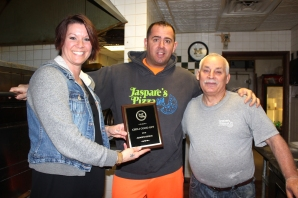 Jaspare's Pizza was the Judge's Choice for the Chili Cookoff's contest. Mandy Miller, president of the Vicksburg Area Chamber of Commerce awards the plaque to Todd Glenn, the owner of Jaspare's, and Jaspare Matranga on the right.