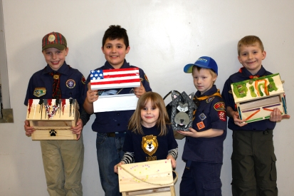 Holding their feeders, the scouts and their dens, from left, are Caleb Bombich, Webelo; Henry Stamm, Bear; Madeline Trepanier, Lion; William Tassell, Wolf; Blake Jastifer, Tiger. Bidding winners came to the troop's meeting site at Vicksburg United Methodist to pick up their feeders.