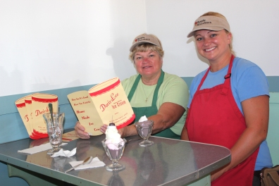 Paula Hochstetler and Rita Sertic from Apple Knockers are shown serving ice cream in the Doris Lee Sweet Shop at the Historic Village during one of the Historical Society's events.