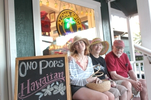 Jael Aumack of Seattle, Mary and John Scott of Lake Leland are seated in front of the Aloha Spice store on Kauai'I island in Hawaii. The Scotts were long-time Vicksburg residents and neighbors of the editor for many years.